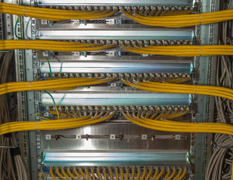 Patch panel in a data center. A Patch panel in a data center with cables stock images