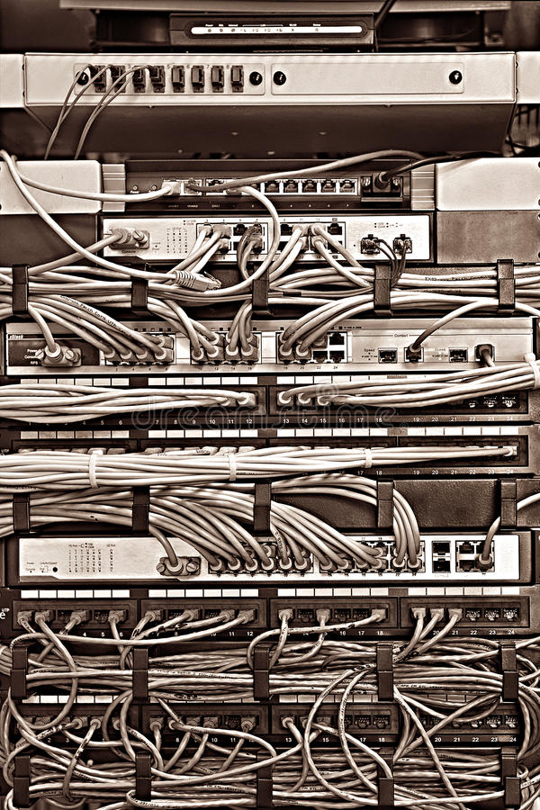Patch Panel server rack with cords in different colors stock images