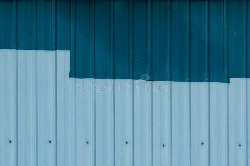 Patched Corrugated Metal Sheet. stock photo