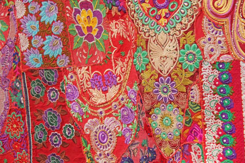 Patchwork of indium. India embroidery colored squares. Bright multicolored red Indian oriental background. Patchwork of indium. India embroidery colored. Bright stock images