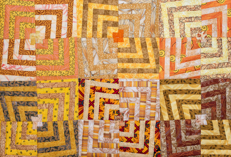 Patchwork. In orange, yellow and brown fabrics royalty free stock photography