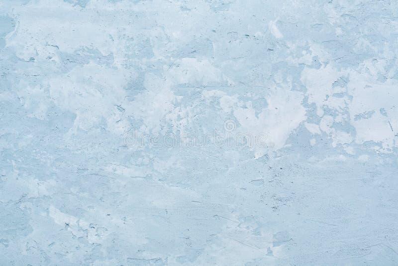 Patchy textur av den blåa betongväggen eller den abstrakta murbrukbackgroen arkivfoto