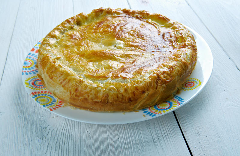 Pate aux pommes de terre. Speciality of the Limousin and the Allier . main ingredients are potato slices and crème fraîche, which are used to fill a puff stock image
