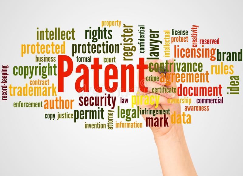 Patent word cloud and hand with marker concept stock image