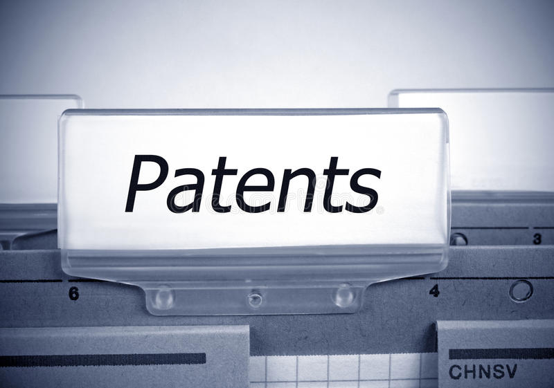 Patents Register Folder Index. With text and spotlight effect in the office stock photo