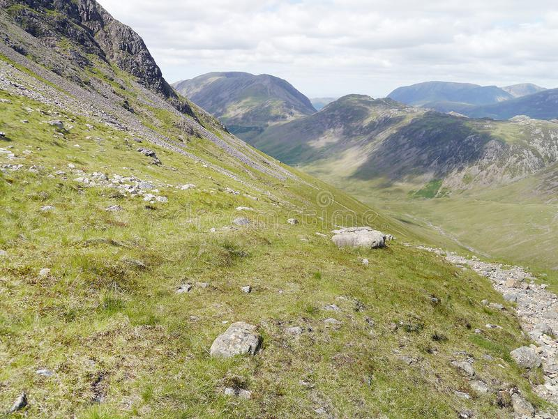 Looking down Ennerdale from northern face of Kirk Fell. On path below Kirk Fell, Lake District, looking westwards down the Ennerdale valley stock photos