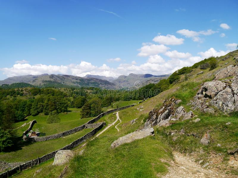 Path below Loughrigg Fell, Lake District. Langdale Pikes seen from path below Loughrigg Terrace royalty free stock photography
