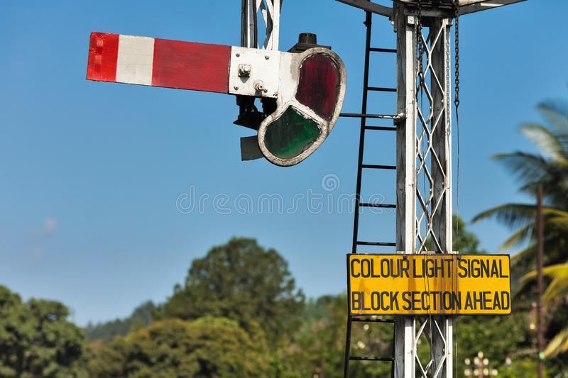 Old British semaphore say - The path is closed. An old British semaphore mounted on a railway in Sri Lanka indicates that the road is closed stock photos