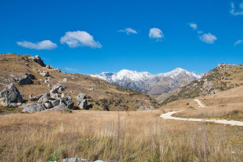 A path heading toward the distant mountains stock photo