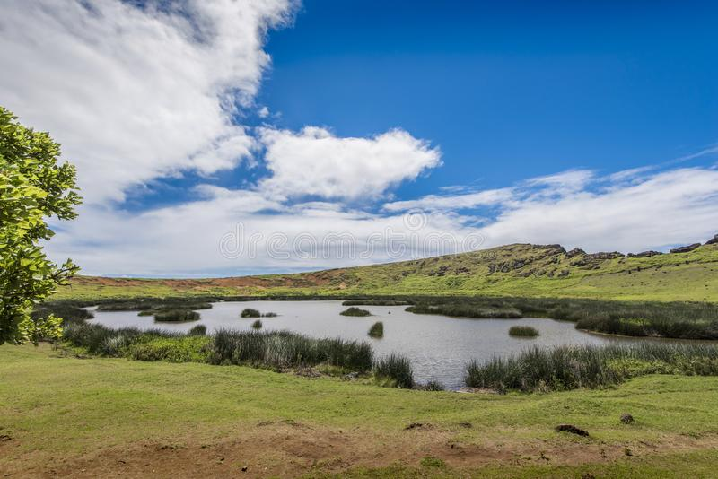 Rano Raraku volcano crater with underground moai. Path on the hill of the moais of the Rano Raraku volcano where all the moai were sculpted royalty free stock images