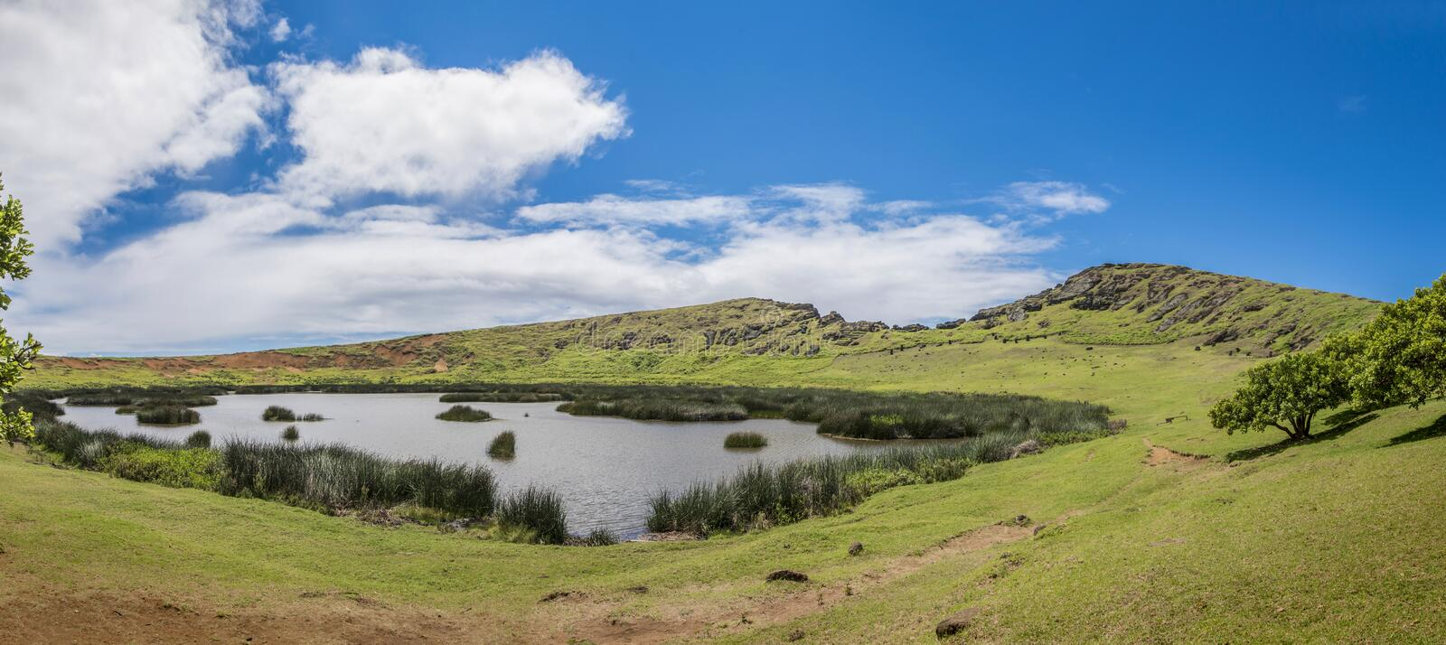 Overview of the interior of the Rano Raraku volcano with underground moais. Path on the hill of the moais of the Rano Raraku volcano where all the moai were royalty free stock photos
