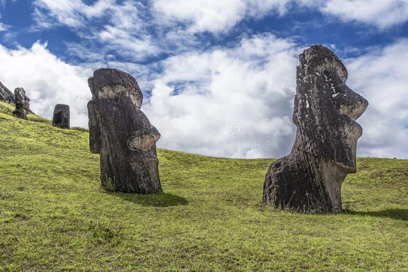 Pair of underground moai on the Rano Raraku hill. Path on the hill of the moais of the Rano Raraku volcano where all the moai were sculpted royalty free stock photo