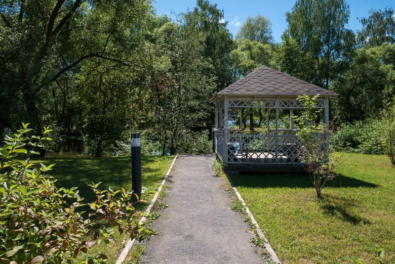 Path leading to wooden summerhouse stock images