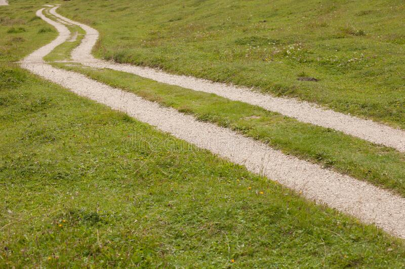 A path long a mountain pasture in Val Gardena royalty free stock photo