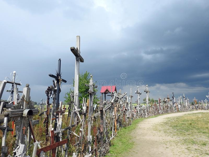 Old cross and path in Cross hill, Lithuania stock photos