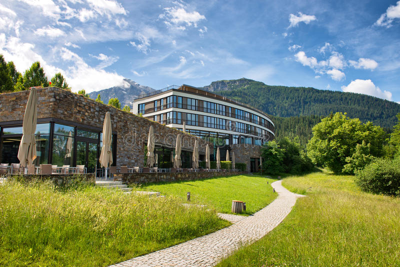 Path Passing by Kempinski Hotel Berchtesgaden. Walking Path Through Green Grounds of Kempinski Hotel Berchtesgaden, a Luxury 5 Star Hotel in the Bavarian Alps stock photo