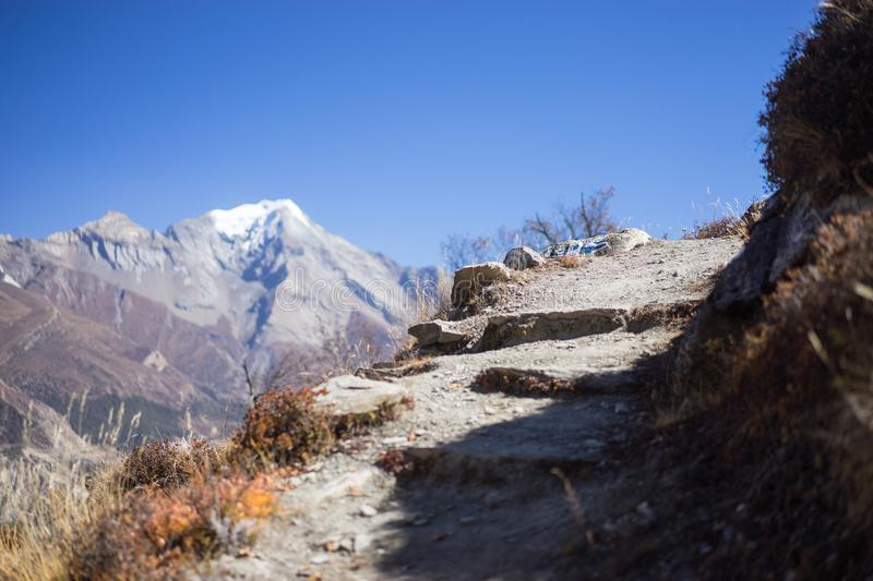 Path and Peak in the Himalaya mountains, Annapurna region, Nepal royalty free stock image