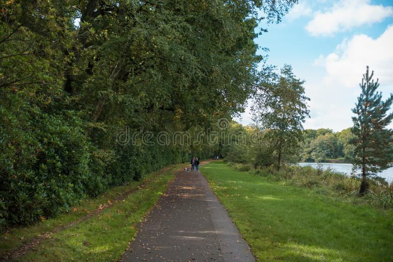 LONDON, ENGLAND - SEPTEMBER 28, 2017: Path and People in Windsor Great Park in England. royalty free stock photo