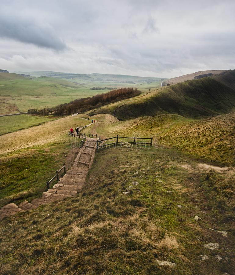 A path runs through the Peak District from Mam Tor on a windy winters day stock images