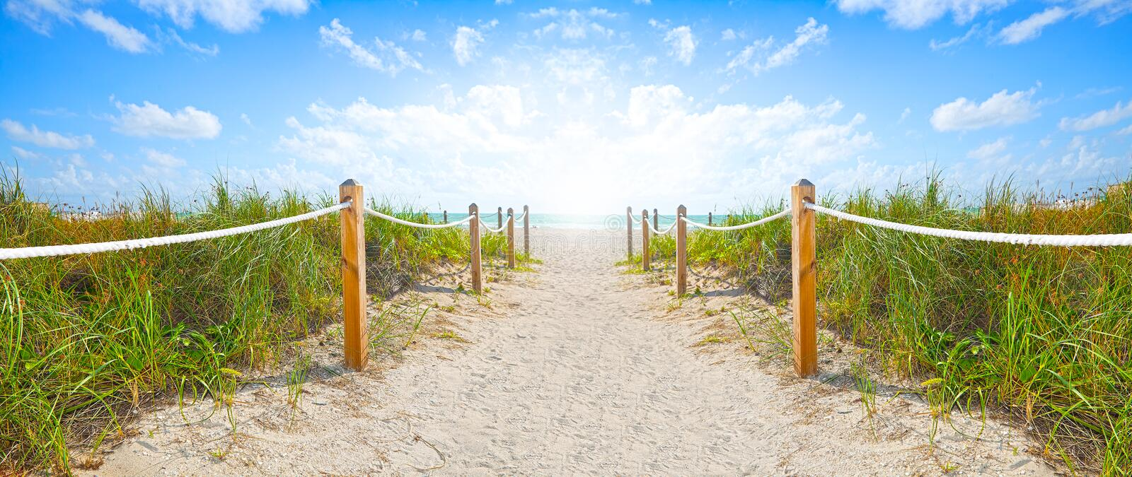 Path of sand going to the beach and ocean in Miami Beach Florida royalty free stock image
