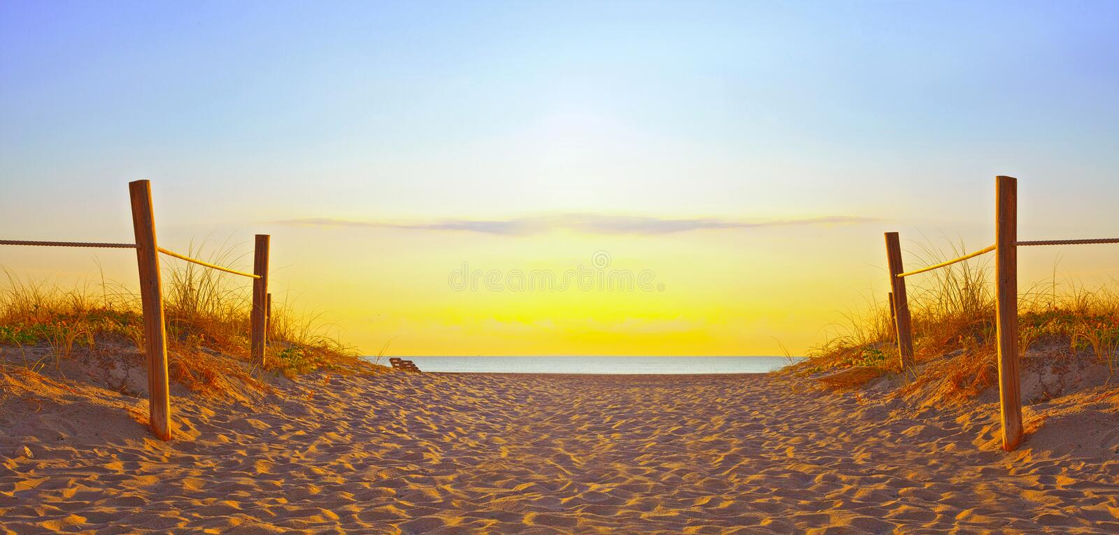 Path on the sand going to the ocean in Miami Beach Florida stock images
