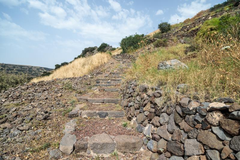 A path with stairs in ruins of the ancient Jewish city of Gamla on the Golan Heights destroyed by the armies of the Roman Empire i. A path with stairs in ruins stock image