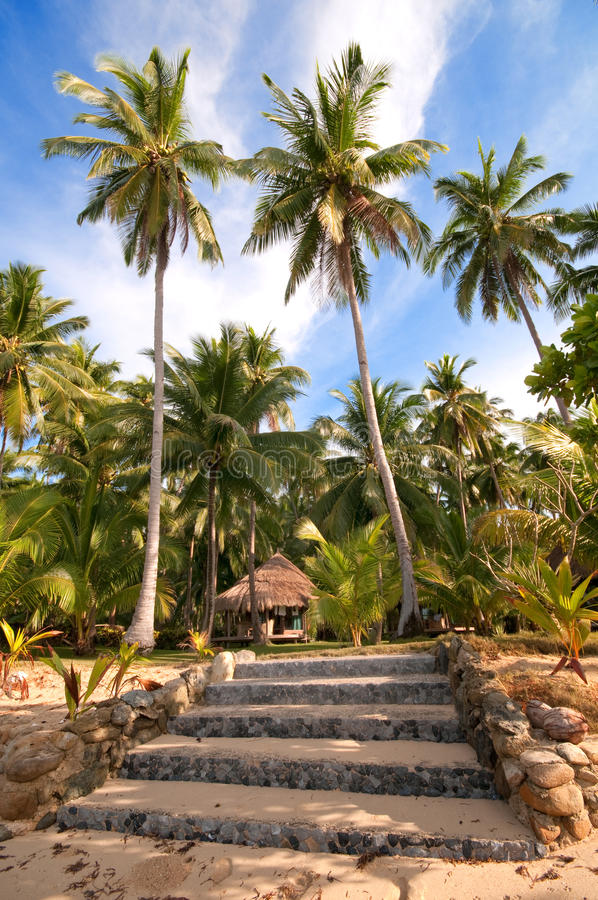 Path with steps to a tropical villa at the beach. Steps leading to a tropical villa stock photography