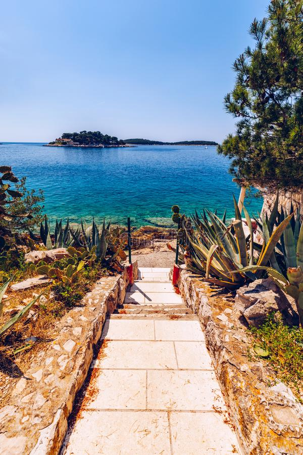 Path To The Beach. Path to the rocky beaches of the Adriatic sea. Path to the beach at Adriatic sea. Hvar, Croatia royalty free stock photo