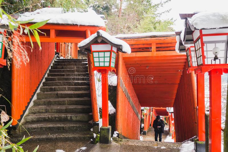 The path to climb up the hill to go to Taikodani Shrine is filled with red Torii Pillars. Taikodani shrine has red tangerine pillars all the way up hill, making royalty free stock photos