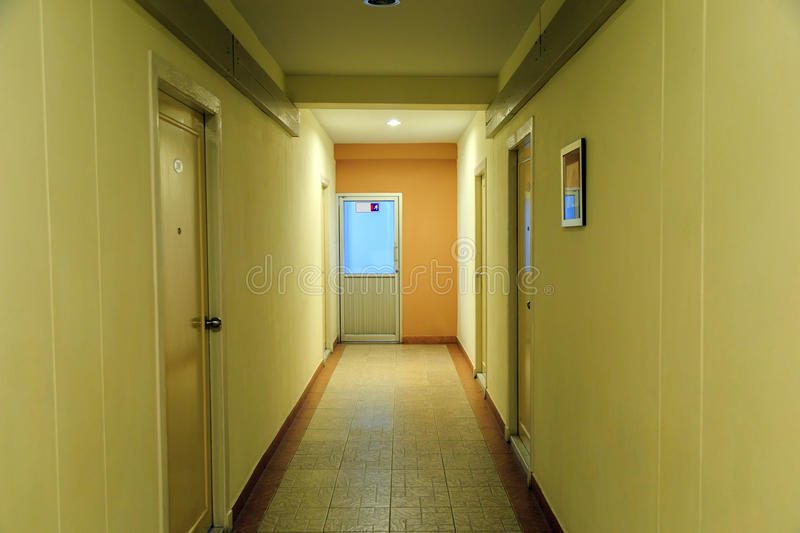The path to the fire exit door in the hotel. Hotel corridorh to the fire exit door in the hotel stock photography