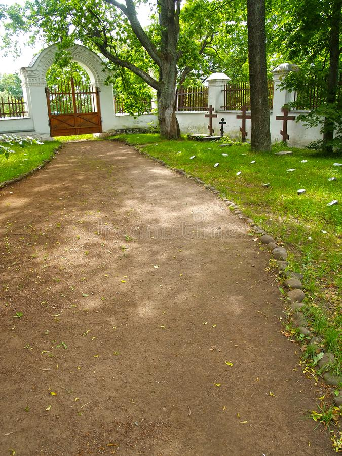 Path to gate at the old brotherly cemetery. Valaam Spaso-Preobrazhensky stavropegial monastery royalty free stock photo