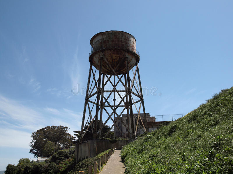 Path to Rusted out Water Tower stock photography