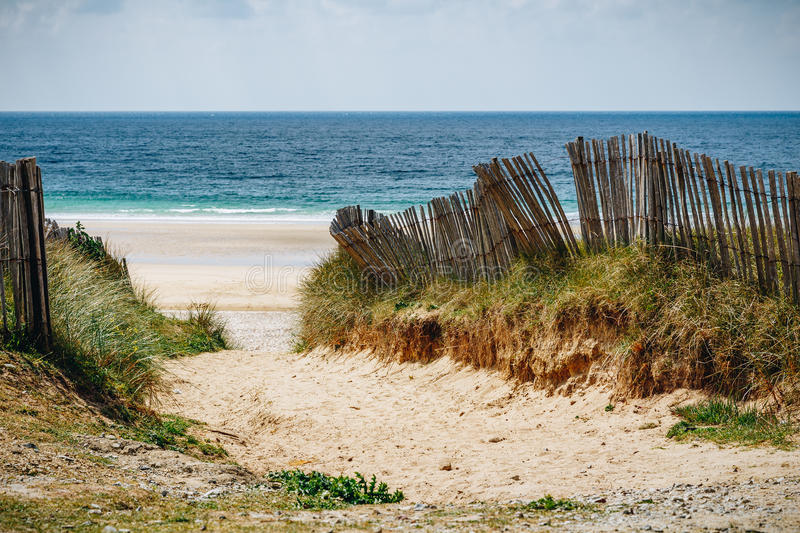 Path to sand beach with beachgrass. Way to the wide sandy beaches of the Atlantic. stock photography
