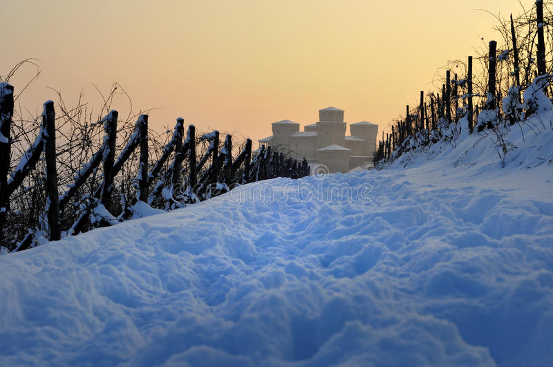 The path to Torrechiara Castle covered by snow stock images