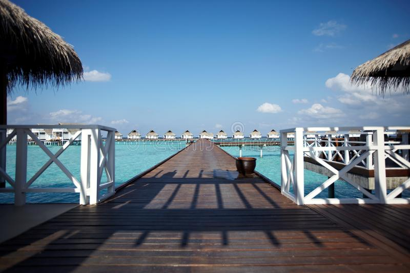 Path to water villas royalty free stock photography