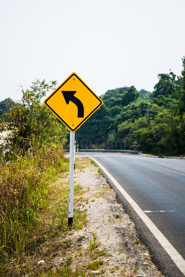 Path turns to the left with sign royalty free stock photography
