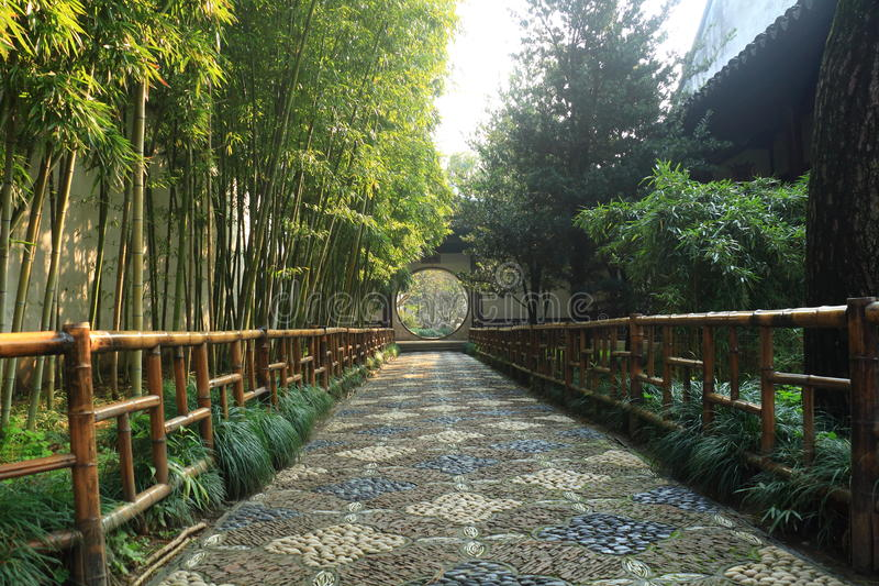 A path through two rows of trees at liuyuan garden at autumn stock photography