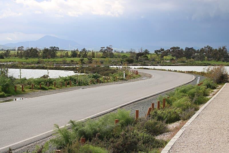 Path between two salt lakes that leads to Hala Sultan Tekke mosque, Larnaca, Cyprus royalty free stock photos