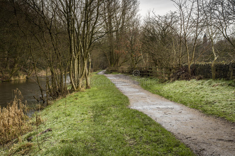 Path winding by the canal at Daisy Nook. Path winding by the canal in Winter at Daisy Nook Country Park, Lancashire,England royalty free stock image