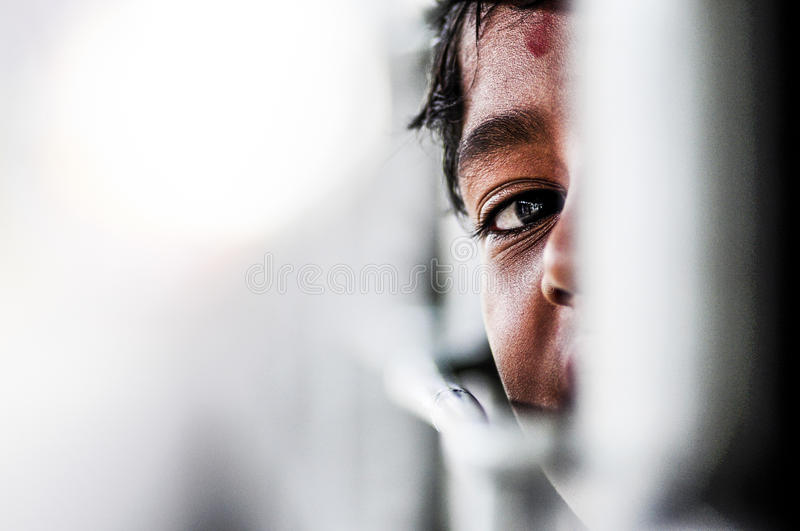 Pathankot, India, september 9, 2010: Indian kid playing hide and. Seek on a train in India stock images