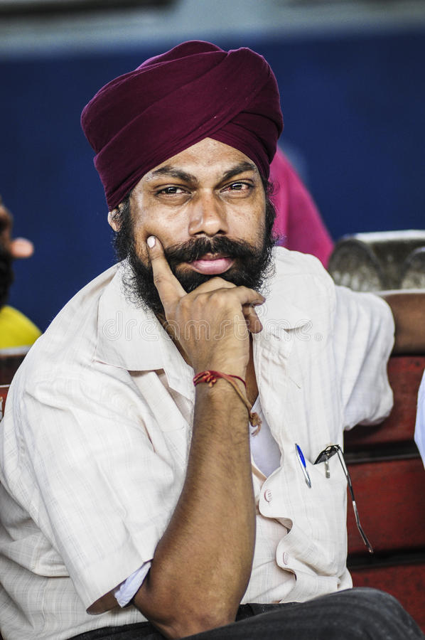 Pathankot, India, september 9, 2010: Portrait of indian man in t. Urban and beard royalty free stock photos