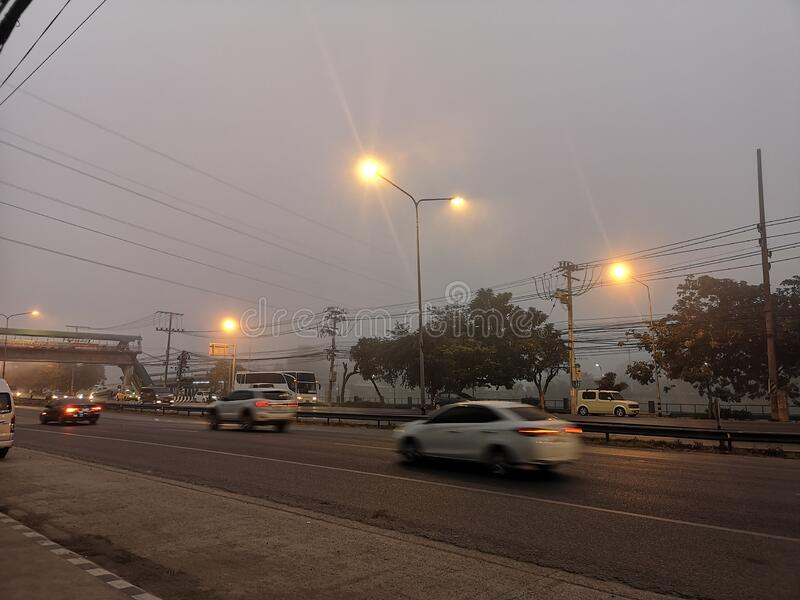 Pathum Thani, Thailand-December 25,2019; Morning fog on the road. Environment stock photography