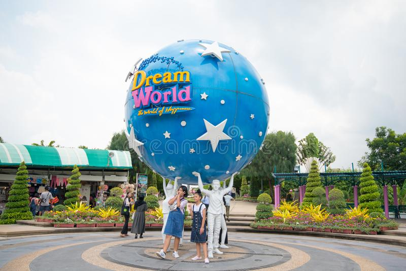 Tourist take photo The large Dream World logo globe.Dream World is one of Thailand`s. PATHUMTHANI, THAILAND - April 27, 2019 : Tourist take photo The large Dream stock images