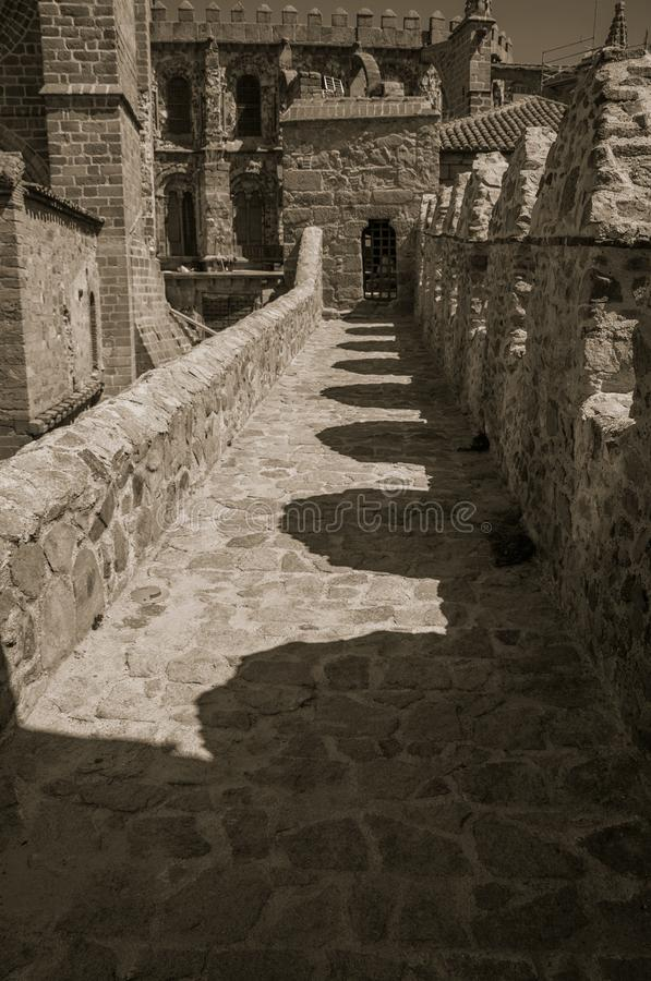Pathway over wall around the town and Cathedral of Avila. Path over old stone wall with battlement around the town and Cathedral at Avila. It has the longest and royalty free stock image