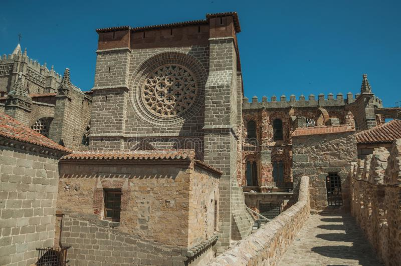 Pathway over wall around the town and Cathedral of Avila. Pathway over thick stone wall with battlement around the town and side view of Cathedral at Avila. It stock image