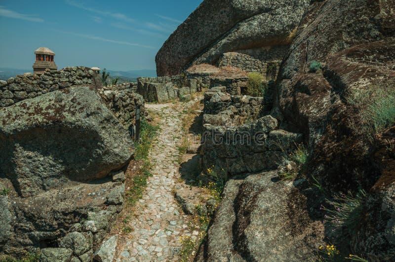 Pathway passing through big rocks in Monsanto royalty free stock photos