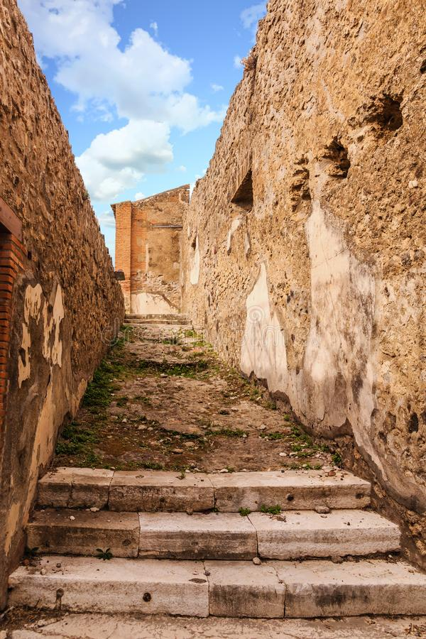 Pathway in Pompeii. Details of the Ancient city of Pompeii destroyed by volcano of Vesuvius royalty free stock image