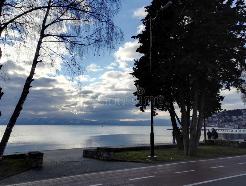 Pathway and promenade next to the Ohrid lake. Photo of pathway and promenade next to the Ohrid lake, stunning sky in background, Republic North Macedonia royalty free stock images