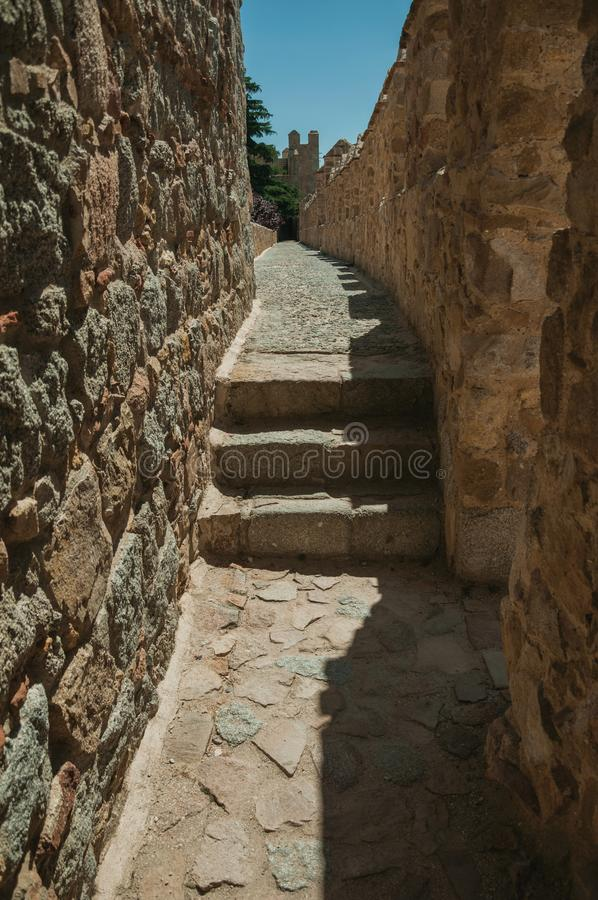 Pathway with stairs over wall with battlement around Avila. Pathway with stairs over thick stone wall with battlement around the town, in a sunny day at Avila stock images