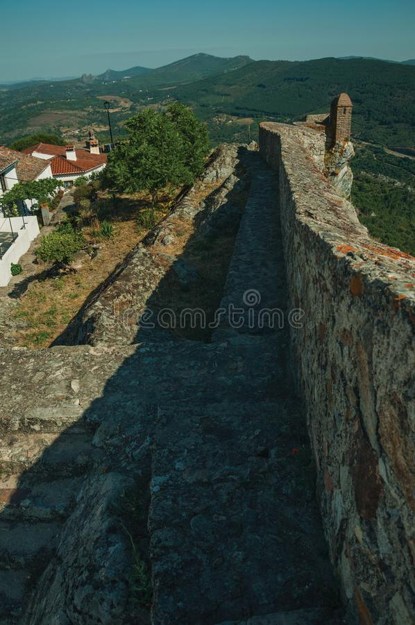 Pathway on stone wall with watchtower over ridge in Marvao royalty free stock photos
